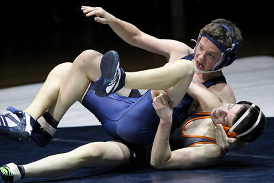 Lauren M. Anderson - landerson@shawmedia.com Cary-Grove's Mike Altendorf gets pinned by McHenry's Mike Sikula during their 113-lb match on Thursday. Sikula got the pin at 1:05 in the first period.