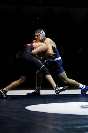 Lauren M. Anderson - landerson@shawmedia.com Cary-Grove's Mike Underwood (right) lunges into McHenry's Tony Lopez during their 132-lb match on Thursday.