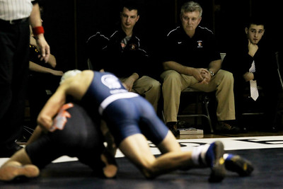 Lauren M. Anderson - landerson@shawmedia.com McHenry wrestling head coach Will Gaddy (second from right) watches a match against Cary-Grove on January 5, 2012.
