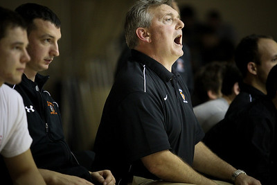 Lauren M. Anderson - landerson@shawmedia.com McHenry's head coach Will Gaddy yells from the bench during a match against Cary-Grove on Thursday.