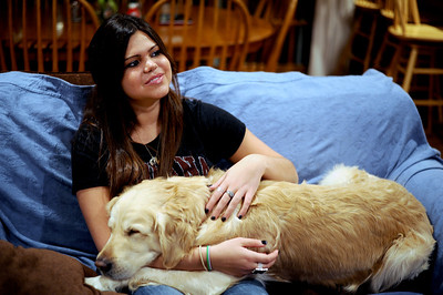Sarah Nader - snader@shawmedia.com Colleen Smith, 19, of Cary hangs out with her dog, Duke, while at her parents home in Cary on Friday, January 6, 2012. Smith who plays volleyball at Indiana University missed her freshmen season and now will miss her sophomore season after coming down with a virus called Wegener's granulomatosis last year.