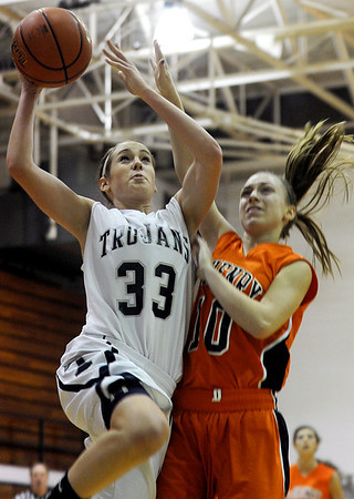 Sarah Nader - snader@shawmedia.com Cary-Grove's Paige Lincicum (left) is guarded by McHenry's Laura DAngelo while she takes a shot during the third quarter of Friday's game in Cary on January 6, 2012. Cary-Grove won, 39-18.