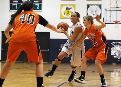 Sarah Nader - snader@shawmedia.com Cary-Grove's Joslyn Nicholson (Center) is guarded by McHenry's Michelle Kelly (Left) and Emma Romme while she brings the ball down court  in the first quarter of Friday's game in Cary on January 6, 2012. Cary-Grove won, 39-18.