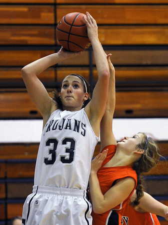 Sarah Nader - snader@shawmedia.com McHenry's Emma Romme (right) jumps to block a shot by Cary-Grove's Paige Lincicum during the third quarter of Friday's game in Cary on January 6, 2012. Cary-Grove won, 39-18.