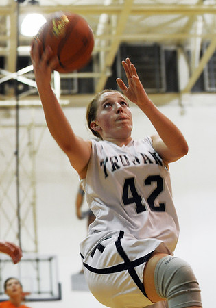 Sarah Nader - snader@shawmedia.com Cary-Grove's Olivia Jakubicek takes a shot during the second quarter of Friday's game against McHenry in Cary on January 6, 2012. Cary-Grove won, 39-18.