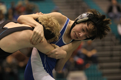 Lauren M. Anderson - landerson@shawmedia.com Woodstock's Joe Kruse escapes the grasp of Woodstock North's Chris Nuelle during their 106-lb match on Friday.