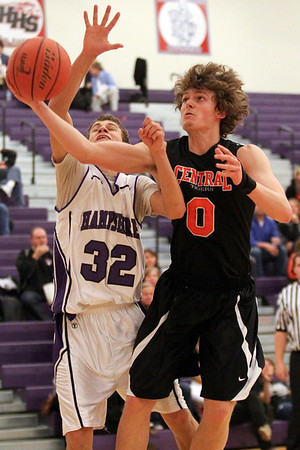 Lauren M. Anderson – landerson@shawmedia.com Hampshire's Ryan Cork attempts to block a shot put up by Crystal Lake Central's Nick Decoster in the third quarter on Saturday. The Whippurs defeated the Tigers 52-47.