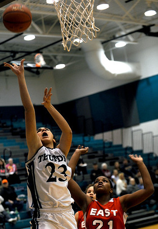 Sarah Nader - snader@shawmedia.com Rockford East's Jasena Ford (right) tries to block a shot by Woodstock North's Samantha Abbate during the first quarter of Monday's non-confrence game in Woodstock on January, 9, 2012. Woodstock North won, 48-19.