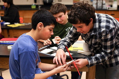 Lauren M. Anderson - landerson@shawmedia.com Joseph Correa, 13, Sam Debruyne, 13, and Rory Pipia, 14, build their wind turbine during class on Wednesday as part of Engineering Week at Hannah Beardsley Middle School in Crystal Lake.