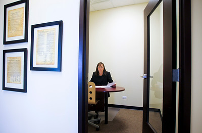 Photo by Jenny Kane - jkane@shawmedia.com Wed. Jan. 11, 2012, Cindy McMahon, Contract and Search Specialist at Express Employment Professionals, reviews applications, calls references and verifies information for the company. On average Express Employment Professionals handles 75-100 applications daily. McMahon has been with the company for the past three years.