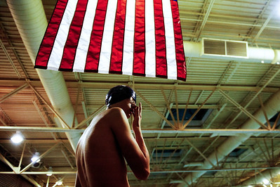 Daniel J. Murphy - dmurphy@shawmedia.com  Cary-Grove senior Eric Marchessault adjusts his goggles before racing in the JV 400-meter Freestyle Wednesday January 11, 2012 at the Rakow Center in Carpentersville, IL.