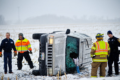 Daniel J. Murphy - dmurphy@shawmedia.com  McHenry County fire and police prepare to tow a vehicle that rolled off Ridgefield Rd. Thursday January 12, 2012 just outside of Ridgefield. The National Weather service is predicting 4-8 inches of snow today and tonight with northwest winds between 15 and 20 mph.