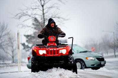 Daniel J. Murphy - dmurphy@shawmedia.com  Paulino Fernandez of Crystal Lake clears snow outside of Regal Cinemas Thursday January 12, 2012 in Crystal Lake. The National Weather service is predicting 4-8 inches of snow today and tonight with northwest winds between 15 and 20 mph.