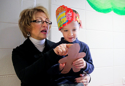 Jenny Kane - jkane@shawmedia.com Cheryl Vaughn looks at a Gingerbread man decorated by Evan Lamb during the four year old's preschool class at St. Barnabas Christian Preschool in Cary. Evan and his twin Jack had birthday hats on to celebrate their birthday week.