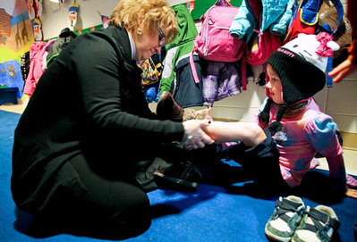 Jenny Kane - jkane@shawmedia.com Cheryl Vaughn helps Lily Rymsza put on her snow shoes so that Lily can play outside in the snow with the rest of the four year olds at St. Barnabas Christian Preschool in Cary. Last year Vaughn helped put together a campaign to raise money for the Cary Grove Food Pantry. She organized a pancake breakfast, solicited donations from businesses and held car washes. The community raised $16,000 for the food pantry. She also has been director of the preschool for 13 years, and has overseen it's growth from 4 staff members to 10, and from 40 students to 120 students.