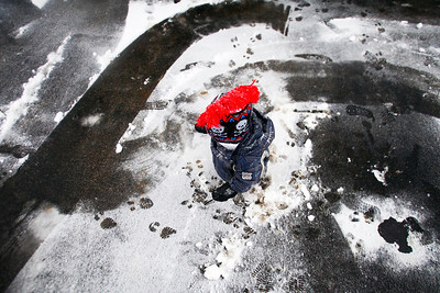 Lauren M. Anderson - landerson@shawmedia.com Christopher Thompson, 18 months, of McHenry walks around the driveway that his mother Robin Joslyn had just shoveled on Thursday. McHenry County is expecting four to eight inches of snow with the winter storm that rolled in yesterday.