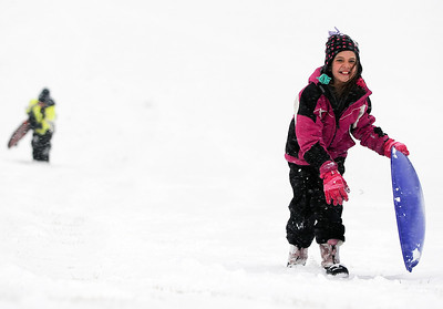 Sarah Nader - snader@shawmedia.com Kate Nemeth, 9, of Cary carries her sled up the hill while enjoying the first snow fall of the year at Lions Park in Cary on Thursday, January 12, 2012.