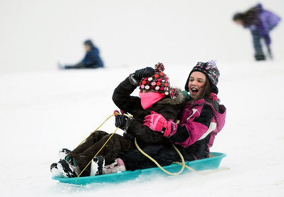 Sarah Nader - snader@shawmedia.com Madelyn Coles (left), 9, and Kate Nemeth, 9, both of Cary hold on tight while sledding at Lions Park in Cary during the first snow fall of the year on Thursday, January 12, 2012.