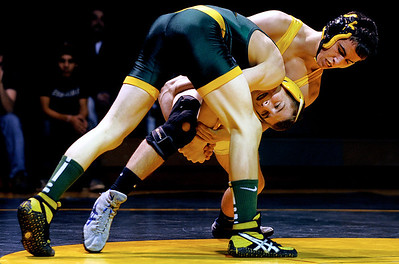 Sarah Nader - snader@shawmedia.com Crystal Lake South's Nick Peters (right) grabs onto Jacobs' Collin Zaio during their 138-lb match at Thursday's FVC Valley matchup in Crystal Lake on January 12, 2012. Crystal Lake South won, 38-32.