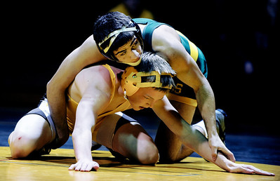 Sarah Nader - snader@shawmedia.com Crystal Lake South's Nick Gil (top) grabs onto Jacobs' Mike Ricks during their 132-lb match at Thursday's FVC Valley matchup in Crystal Lake on January 12, 2012. Crystal Lake South won, 38-32.