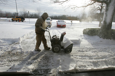 H. Rick Bamman -hbamman@shawmedia.com Don Busse clears his driveway Friday morning on the 700 block of Circle Drive in Algonquin. Today will reach a high of 18 with wind gusts to 35 mph it will feel like it's in the single digits.