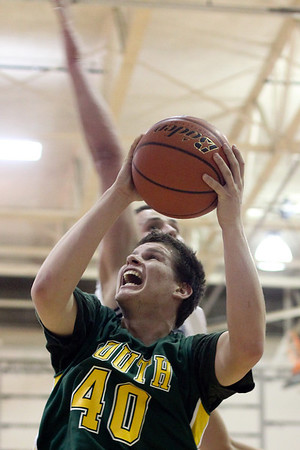 Lauren M. Anderson - landerson@shawmedia.com Crystal Lake South's Max Meitzler jumps to the hoop in the second quarter on Friday against Cary-Grove.