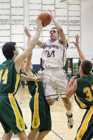Lauren M. Anderson - landerson@shawmedia.com Cary-Grove's Jake Bianchi (24) puts up a shot in the third quarter against Crystal Lake South's Matt Benoit (44) Alex Bartusch (5) and Nick Geske (32) on Friday during their FVC Valley matchup. The Gators defeated the Trojans 48-44.