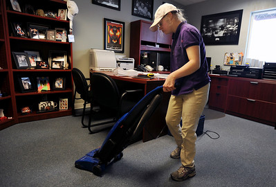 Sarah Nader - snader@shawmedia.com Rosie Dietz, 20, of Harvard vacuums all the offices while at work at The Pound Bakery in Harvard on Friday, January 13, 2012. Dietz works six hours a week at the bakery and mainly cleans the office area and takes care of the trash and recycling.