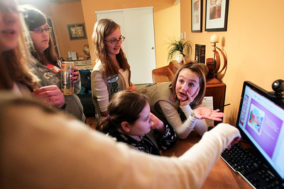 Lauren M. Anderson - landerson@shawmedia.com Emma Lloyd-Mietus, 12, (right) discusses the powerpoint presentation for their Project Linus with fellow troop members Julia Meyer, 14 (left-right) Sammie Longfield, 13, Sarah Meyer, 12, and Caitlyn Stelton, 13, during their Girl Scout meeting on Friday in Crystal Lake.
