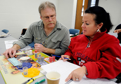 Sarah Nader - snader@shawmedia.com Richco employees Rick Hall (left) of Woodstock and Brenda Krabbe of Poplar Grove are going through a leadership development program with other employees at McHenry County College in Crystal Lake. During Friday, January 13, 2012 the employees participated in an activity where they ran a made up manufacturing company for the day. Winners of the activity earn a contribution to a charity of their choice.