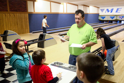 Lauren M. Anderson - landerson@shawmedia.com Gene Schrempf of Crystal Lake checks the lane assignments for those participating in the Jaycees bowling league at Metro Bowl in Crystal Lake on Saturday. Schrempf has been volunteering for the Jaycess since 2002.  (1/14/2012)