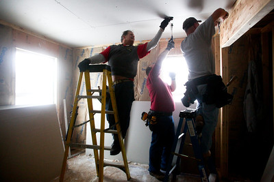 Lauren M. Anderson - landerson@shawmedia.com Marty Lenzen (left) helps install drywall to the ceiling of a Habitat for Humanity house in Marengo on Saturday with Bill Lee of Crystal Lake (center) and Brian Beaulieu of Cary.