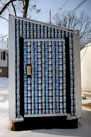 Sarah Nader - snader@shawmedia.com An Ice fishing shanty covered in hundreds of beer cans sits outside the home of Todd Weir in Wonder Lake on Sunday, January 15, 2012. Weir built the shanty and will be using is during the 25th Annual Ice Fishing Derby in Wonder Lake on January 29th.