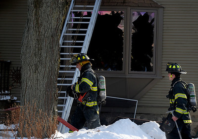 Sarah Nader - snader@shawmedia.com Woodstock firefighters work to put out a fire that occurred in the afternoon on Sunday, January 15, 2012 at 430 E Calhoun Street in Woodstock.