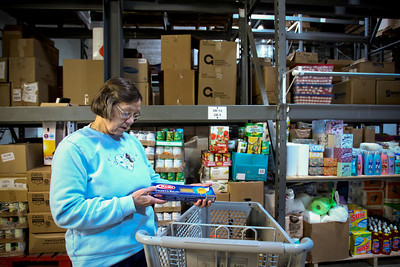 Jenny Kane - jkane@shawmedia.com Volunteer Alice Hallett stalks the shelves at Grafton Township Food Pantry prior to the opening of the pantry for the day. In addition to volunteering at the pantry Hallett fosters puppies and makes prayer shawls for her church.