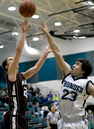 Sarah Nader - snader@shawmedia.com Marengo's Zach Lundquist (left) jumps to block a shot by Woodstock North's Trey Grover during the second quarter of  Monday's Third Annual MLK Classic in Woodstock on January 16, 2012. Woodstock North won, 52-43.