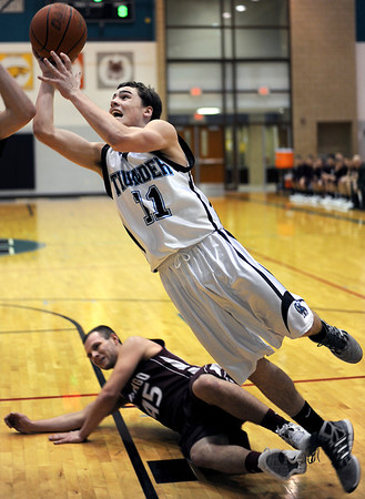Sarah Nader - snader@shawmedia.com Woodstock North's Steven Whiting jumps to make a shot during the third quarter of  Monday's Third Annual MLK Classic in Woodstock on January 16, 2012. Woodstock North won, 52-43.