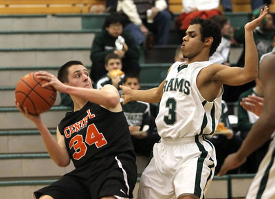 Candace H. Johnson – Shaw Suburban Media Crystal Lake Central's Jake Vanscoyoc tries to maneuver as Grayslake Central's Jordan Taylor defends in the second quarter during the FVC Fox Division matchup game at Grayslake Central High School.