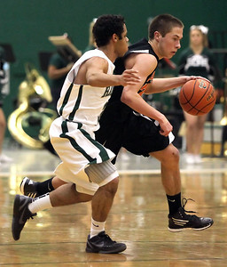 Candace H. Johnson – Shaw Suburban Media Crystal Lake Central's Nick Marchetti drives to the basket against Grayslake Central's Jordan Taylor in the third quarter during the FVC Fox Division matchup game at Grayslake Central High School.