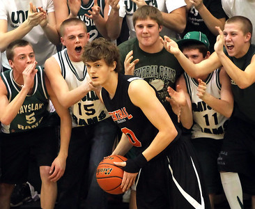 Candace H. Johnson – Shaw Suburban Media Crystal Lake Central's Nick Decoster looks to pass the ball against Grayslake Central as he is heckled by Grayslake Central Super Fans in the first quarter during the FVC Fox Division matchup game at Grayslake Central High School.