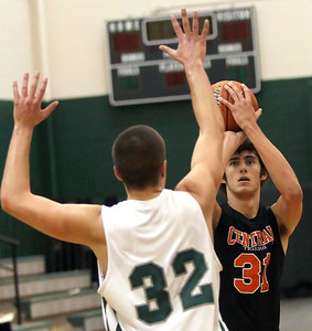 Candace H. Johnson – Shaw Suburban Media Crystal Lake Central's Kyle Fleck looks up for a shot against Grayslake Central's Casey Boyle in the second quarter during the FVC Fox Division matchup game at Grayslake Central High School.