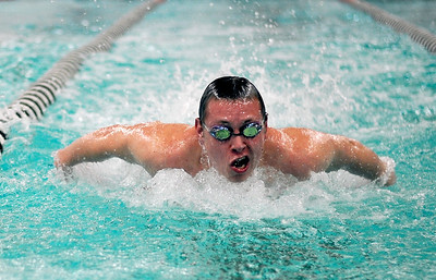 Sarah Nader - snader@shawmedia.com McHenry's Lucas Matthys finishes in second while competing in the 100 Yard Butterfly race during Thursday's FVC dual meet against Woodstock on January 19, 2012.