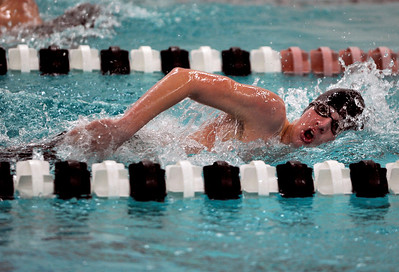 Sarah Nader - snader@shawmedia.com Woodstock's Ben Bradly finishes in second while competing in the 200 Yard Freestyle race during Thursday's FVC dual meet against McHenry on January 19, 2012.