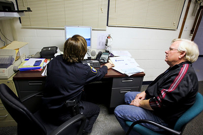 Jenny Kane - jkane@shawmedia.com Roger Pickett, of Cary, works with Officer Kathy Eiring on administrative paperwork for the Police Explorers program in Cary. Pickett is a boycott leader, a key player in the Cary Neighborhood Watch and works with the Police Explorers program in Cary.