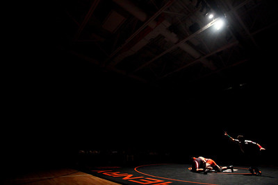 Lauren M. Anderson - landerson@shawmedia.com Huntley's Zach Stenger (left) and Britches Sikula grapple during their 106-lb match on Thursday at McHenry High School-East Campus. Stenger defeated Sikula 6-0.