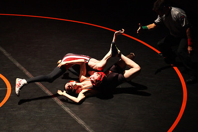 Lauren M. Anderson - landerson@shawmedia.com Huntley's Brandon Meyer (top) flips over McHenry's Mike Sikula during their 120-lb match on Thursday at McHenry High School-East Campus. Sikula defeated Meyer 8-7.