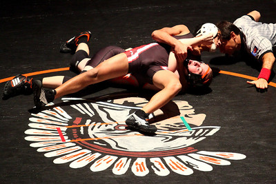 Lauren M. Anderson - landerson@shawmedia.com Huntley's Ricky Vigil (top) pins McHenry's Tyler Chrismas in the first period of their 113-lb match on Thursday at McHenry High School-East Campus.