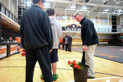 Lauren M. Anderson - landerson@shawmedia.com McHenry wrestling coach Will Gaddy (second from left) hands roses to seniors during senior night on Thursday before their matches against Huntley. (1/19/2012)