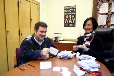Lauren M. Anderson - landerson@shawmedia.com Michael Barrett of Cary (left) and Dawn Iles, principal of Nathan Hale Elementary School in Chicago sorts through Safety or Spirit sheets on Friday. Barrett is the creator of the SpiritDesk which aims to prevent bullying by allowing students to drop notes on classmates that are exhibiting bad behavior. Students can also nominate classmates and teachers for a Spirit Award which honors good behavior. (1/20/2012)