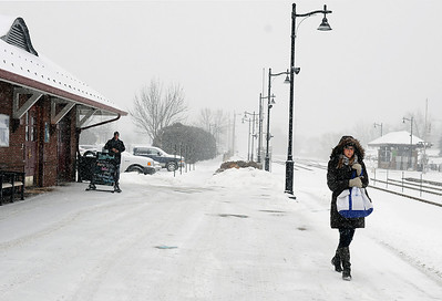 Sarah Nader - snader@shawmedia.com Karen McCann of Palatine waits for the train at the Crystal Lake Metra stop during Friday's snowstorm on January 20, 2012. Accumulations as high as eight inches are predicted, with the deepest snow expected to fall along the Illinois-Wisconsin border.